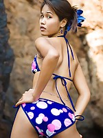 Lily Koh slowly lowers bikini bottoms to expose Asian buns
