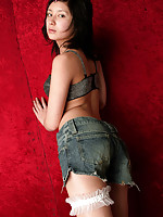 Sensual asian beauty with a perfect body in blue jean shorts