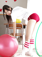 Nagisa Matsayama in sports equipment plays with huge red ball