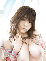Kei Megumi Asian in stockings and heels shows her immense boobs