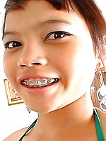 Little Thai beauty Meme gets a huge load of cum sprayed across her braces