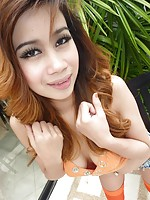 Beautiful Thai teen with red hair shows off her perfect body