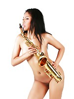 Nude babe Janice playing the saxophone