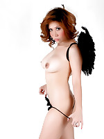 Rayko posing topless in panties and wings