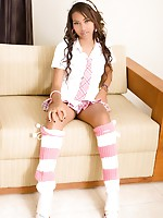 Schoolgirl Anna playfully strips and shows her assets