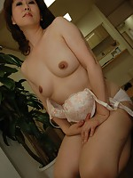 Horny mature Japanese Hitomi Hirano wants some attention to her hairy pussy.