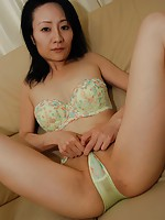 Mature Japanese babe Atsuko Kogure pleasures a dick while teasing herself.