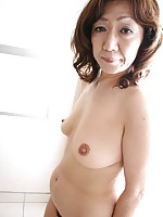 Granny Japanese Eriko Nishimura strips down to get her pussy pleasured while riding cock.