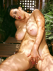 Big chested latina bends over to show her slit