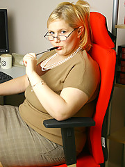 Blonde plumper in stockings stripping in her office
