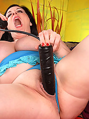 Busty chubby biatch nails herself with black dildo