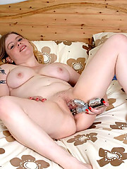 Cute full girlie diddles herself with a large toy