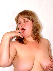 Plump girl showing shaved pussy