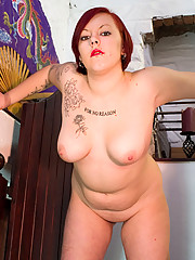 Raunchy red-haired plumper massages her knockers