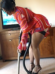 Big butt housewife gets horny while doing the hoovering