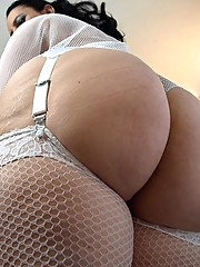 Big booty milf dressed in fishnet shows off her phat white ass