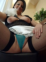 Daniella dressed as a slutty maid in seamed polka dot stockings