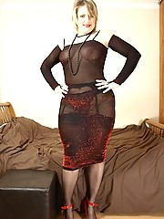 Horny milf Daniella in sheer dress and seamed stockings spreads on her bed