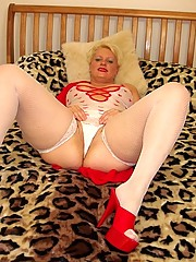 Curvy milf lingerie and fishnets playing with her pussy