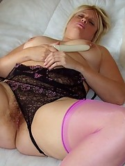 Voluptuous housewife in basque and pink stockings
