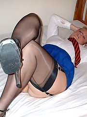 Slut wife in her schoolgirl outfit spreads on bed