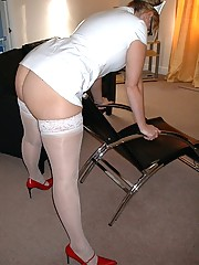 Spectacled nurse in uniform and stockings