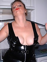 Amateur dominatrix in pvc and boots