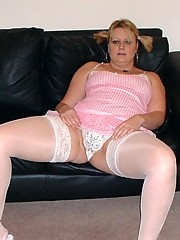 Pigtailed blonde in white stockings
