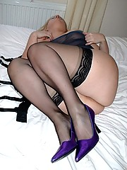 Daniella in black stockings and purple heels