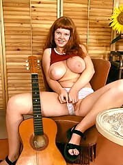 Big breasted redhead pleasing her own tight and pink pussy