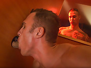 There may only be one guy in the glory hole room, but there is a cock coming out of every hole. This stud goes from cock to cock, eagerly servicing each of them showing how a man can suck! Suddenly, a sexy, shaved headed, muscle guy barges in. A blow job