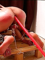 Tied boy bent over for naughty anal insertions
