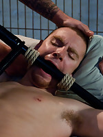 Christian Wilde in police uniform captures and fucks Sebastian Keys in bondage.