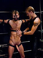 Christian Wilde fucks Zach Alexander tied up and suspended.