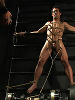 Brenn Wyson ties up two stud in leather hoods and fucks the cum out of them.