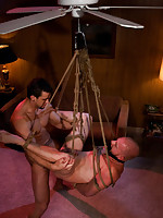 Phenix Saint fucks Luke Riley while Luke is tied up and suspended from the ceiling fan.