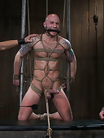 Nick Moretti and Tyler Saint double fuck Drake Jaden in tight bondage.