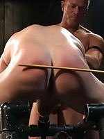 Tyler Saint fucks Luke Riley in bondage on a metal horse during a live show.