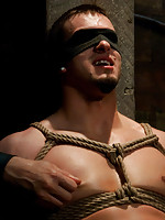 Phenix Saint gets tied up, flogged, and cums all over Patrick Rouge