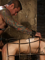 Nick Moretti fucks a pain slut in the electrified metal cage.