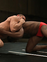 Two muscular studs fight and fuck for real in oil.