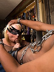 Masked tranny giving a blowjob