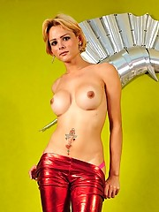 short blonde haired Brazilian tranny Gabriele in a red latex outfit posing