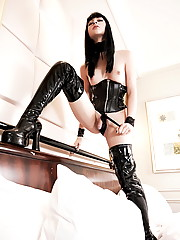 Smoking hot TS babe posing in sexy black long boots