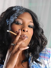 Naughty ebony TS babe smoking a cigarello