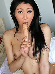 Pretty and slender Tgirl playing with dildo & cumming!
