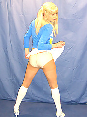 Naughty cheer leader Candi flashes her cute bum