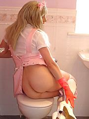 Tgirl maid in saucy outfit cleaning her bathroom and flashing