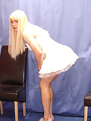 Candi wearing sleek white dress and plays with her cock