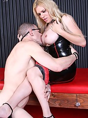 Mistress Jesse has new big boobs and an even bigger ?Bad? attitude. She plants her monster cock in new slave Vic\